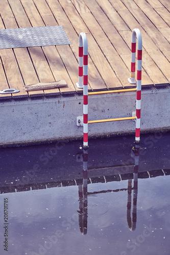 Foto op Plexiglas Poort Vintage toned picture of a marina ladder.