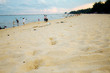 White sand with footprints.