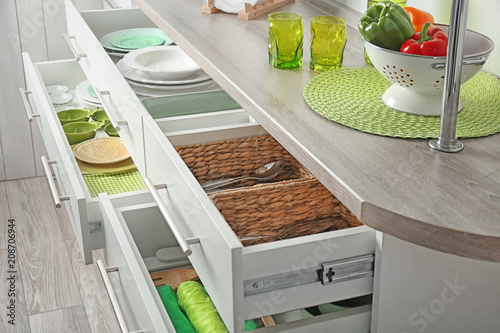Drawers with different kitchenware