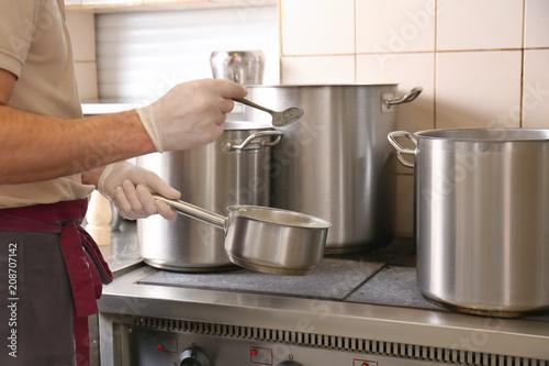 Male chef cooking in restaurant kitchen