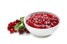 Bowl With Tasty Cranberry Sauce On White Background