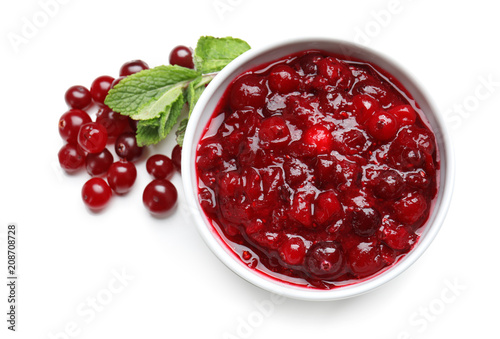 Fototapeta Bowl with tasty cranberry sauce on white background, top view obraz