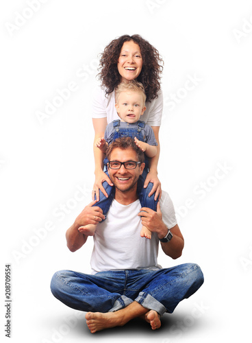 Happy young family laughing and smiling on light background