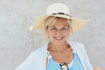 Naklejka Charismatic blond woman in a trendy straw hat