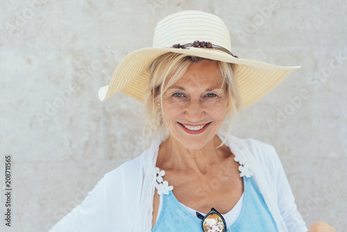 Fotobehang Sportwinkel Charismatic blond woman in a trendy straw hat
