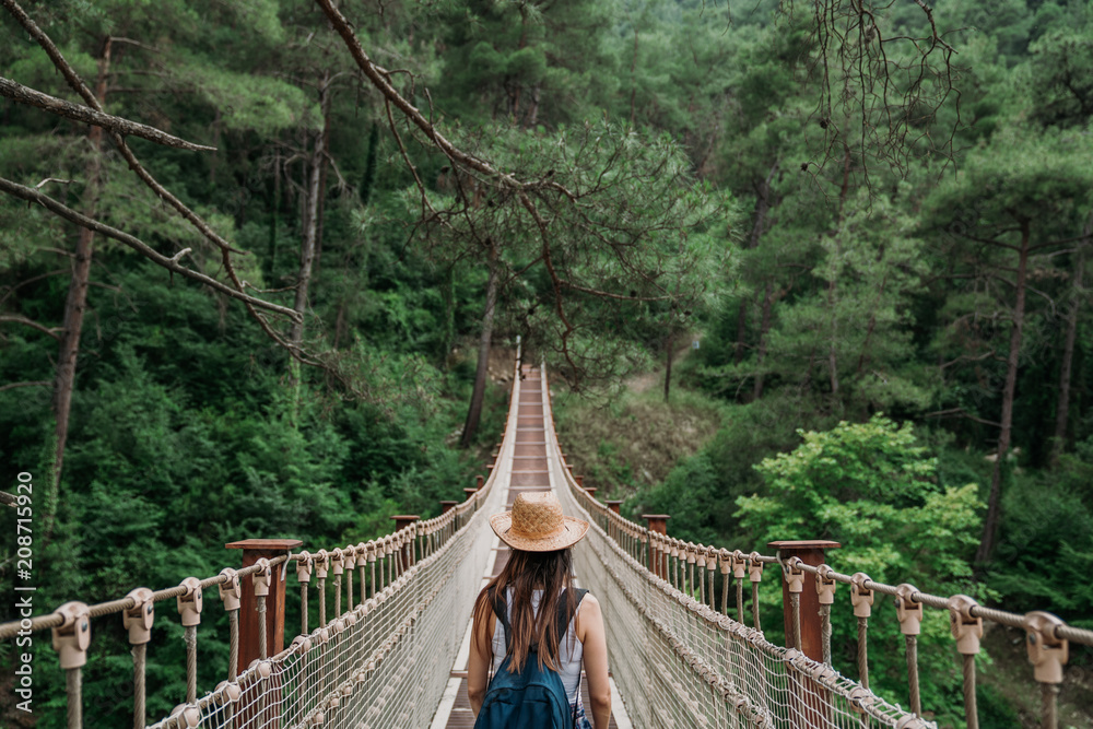 Fototapeta Woman on rope bridge