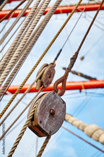 Keuken foto achterwand Schip Close up picture of old sailing ship wooden pulley, selective focus.