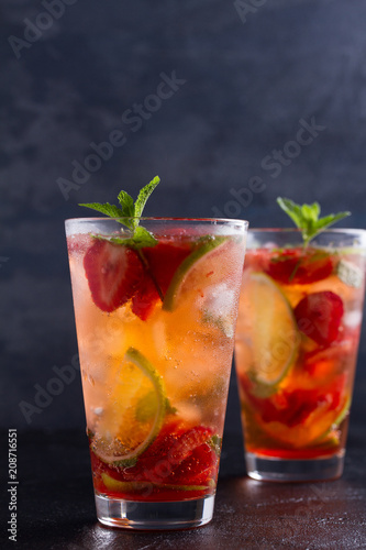 Staande foto Cocktail Strawberry mojito cocktail with berries, lime, mint and ice. Summer berry cocktail