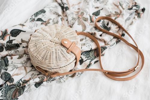 Fotomural Round ladys wickered straw handbag on white linen