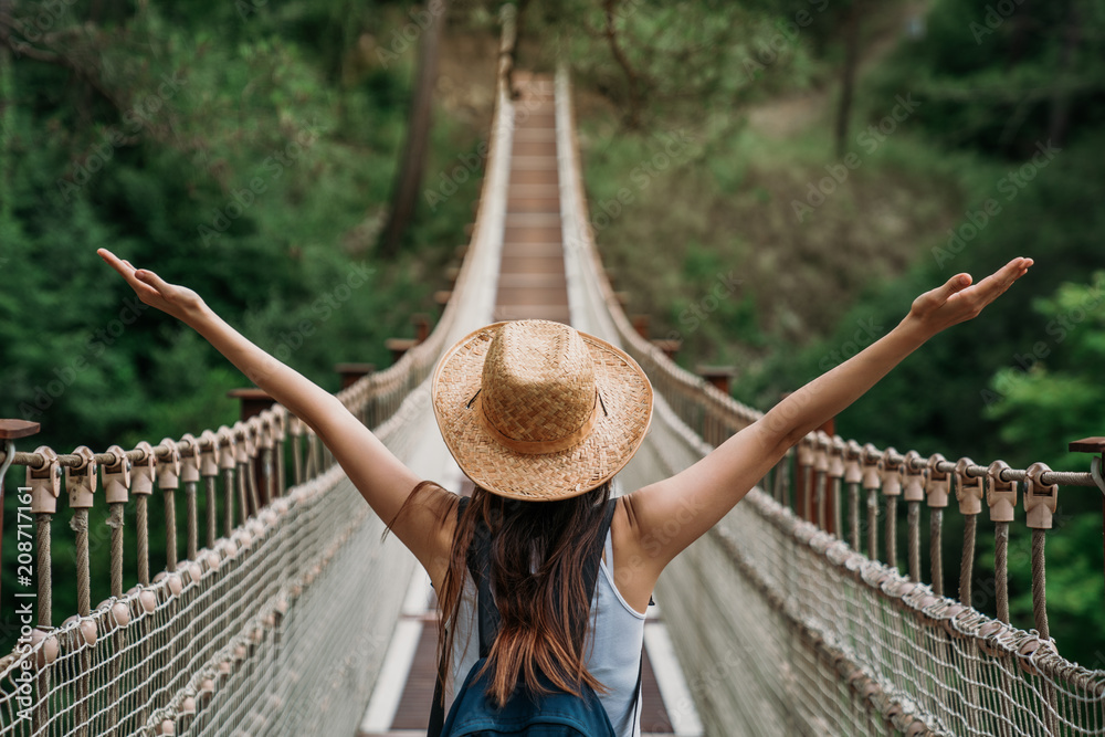 Fototapeta Happy travel woman on vacation concept. Funny traveler enjoy her trip and ready to adventure.