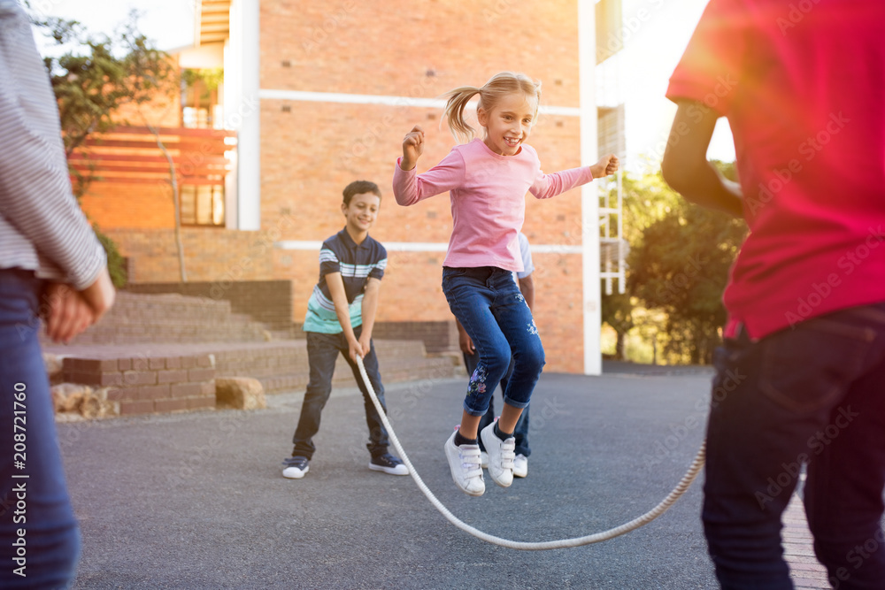 Fototapety, obrazy: Children playing with skipping rope