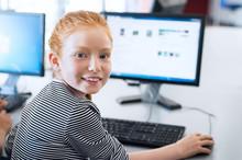 Pupil Girl Using Computer At School