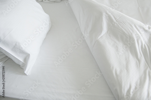 Valokuva  White clean sheets and pillow inviting to go to bed