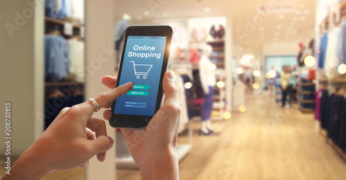 Smart phone online shopping in woman's hand. Network connection on mobile screen. Payments online. Shopping mall department store background