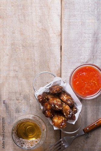 Photo  Spicy chicken chicken wings prepared on barbecue. Top view