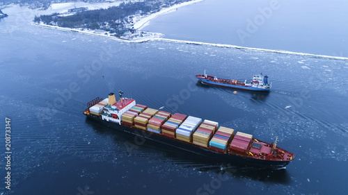 Valokuva  Aerial Shot of the Cargo Ship Moving Through the Sea