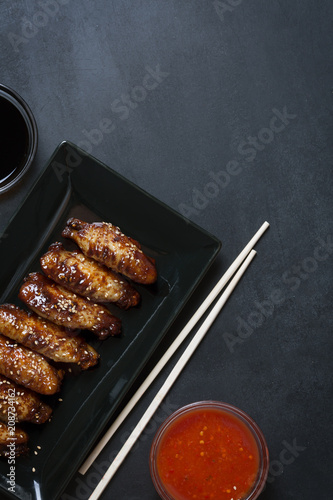 Fotografie, Obraz Traditional Asian stir fry wings with sesame and vegetables