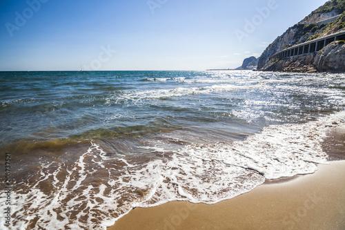 Fotobehang Mediterraans Europa Mediterranean beach Port Ginesta, near to village of Sitges, province Barcelona,Spain.