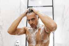 Close Up Of A Handsome Man Having A Shower