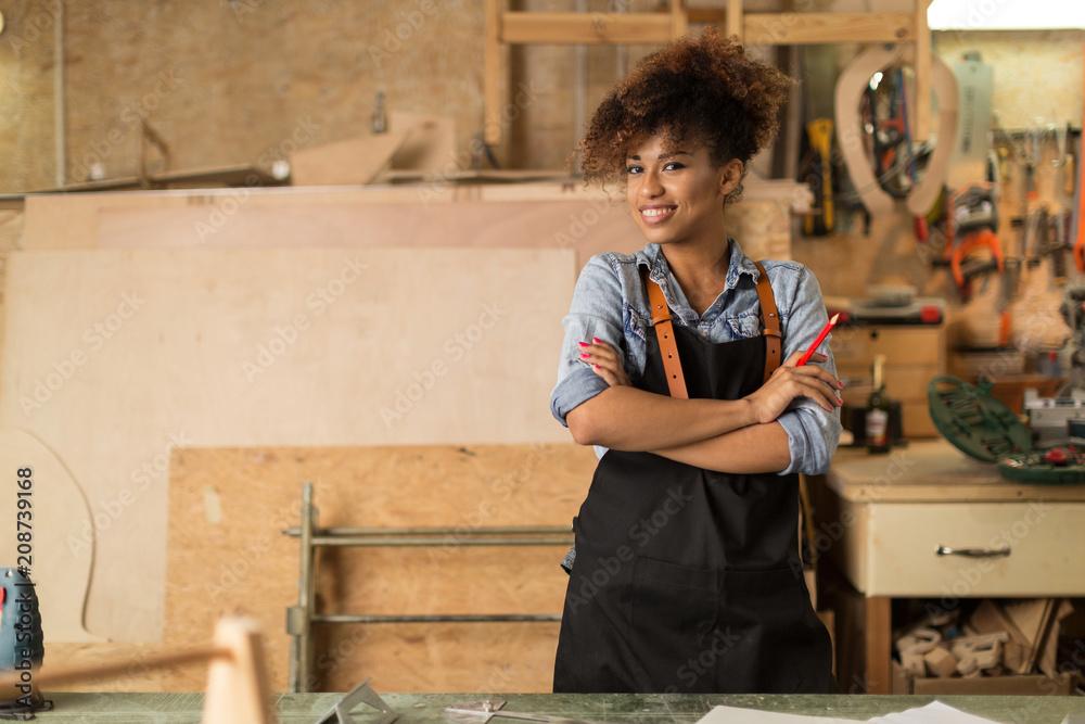 Fototapeta Afro american woman craftswoman working in her workshop   - obraz na płótnie