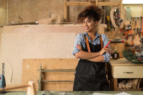 Fototapeta Afro american woman craftswoman working in her workshop   obraz na płótnie