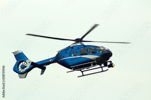 Isolated  helicopter with Czech flag on white background.A flying helicopter with Czech flag on a white background.