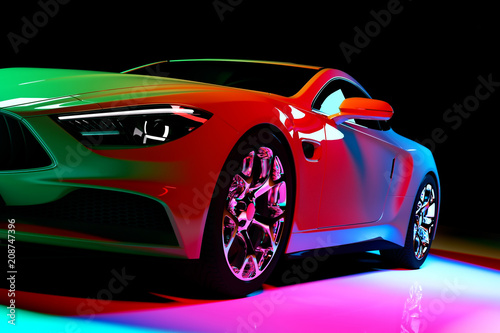 Modern coupe car in colorful spotlights