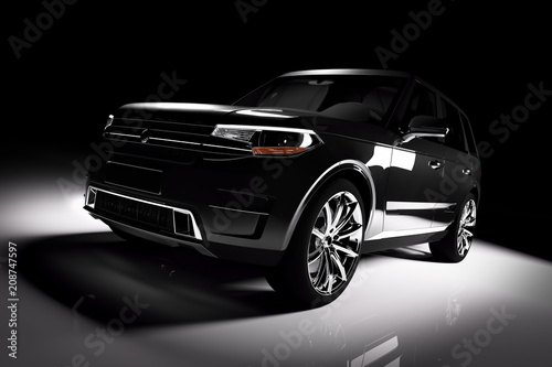 Modern black SUV car in a spotlight on a black background.