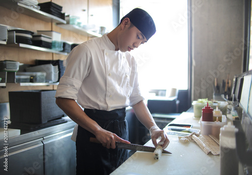 Japanese chef preparing sushi in the restaurant