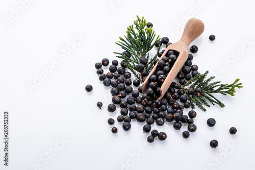 Fototapeta dried juniper berries on a white background obraz