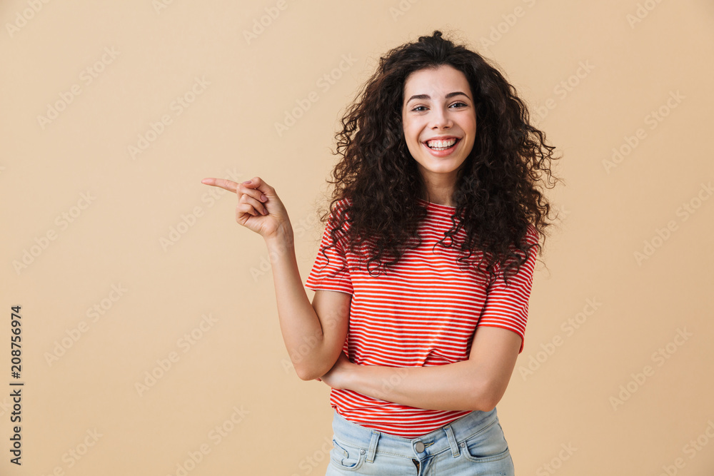 Fototapety, obrazy: Emotional young woman isolated over beige wall