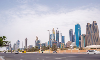 Panorama of the city center of Dubai. Beautiful skyscrapers in cloudy weather.