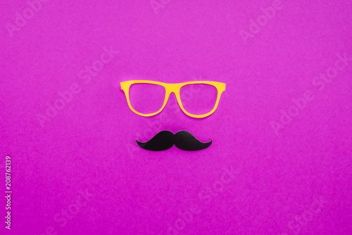 top view of gentleman face made of cardboard eyeglasses and mustache on pink surface - 208762139