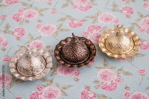 Photo  Golden, Bronze and Silver Cups to Serve Turkish Delight
