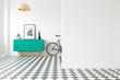 canvas print picture - Empty wall and turquoise cabinet with decorations standing next to a bike in a hallway interior with checkered floor. Place for your poster or furniture