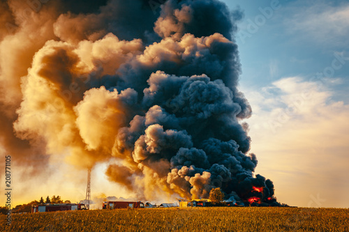 Building fire among fields and huge smoke cloud Canvas Print