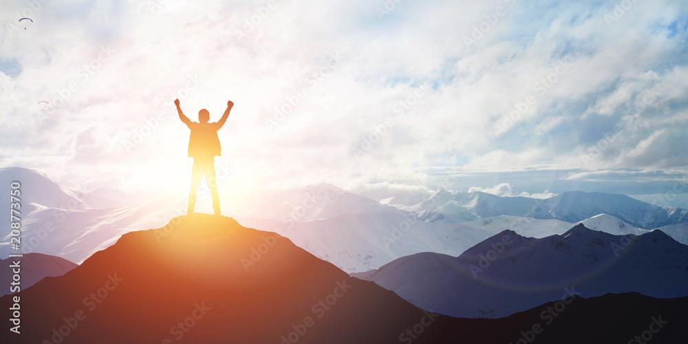 Fototapety, obrazy: Silhouette of male on the peak of mountain