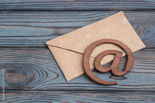 An e-mail symbol on a vintage mail envelope. on the texture of the tree. place for design