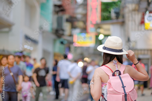 Spoed Fotobehang Japan Young Woman traveling backpacker with hat, Asian traveler standing on Senado Square street, landmark and popular for tourist attractions in Macau. Travel concept