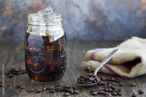 Photo  Iced Coffee in a Jar with a Spoon Full of Coffee Beans