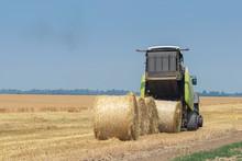 Tractor And Round Baler Discha...