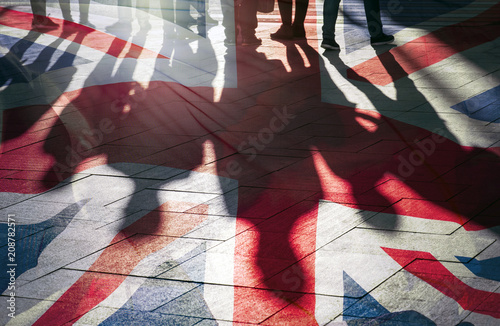Fototapeta Shadows of People and UK Flag Citizens of Great Britain