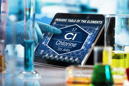 chemist consulting on the digital tablet data of the chemical element Chlorine C Tablou Canvas