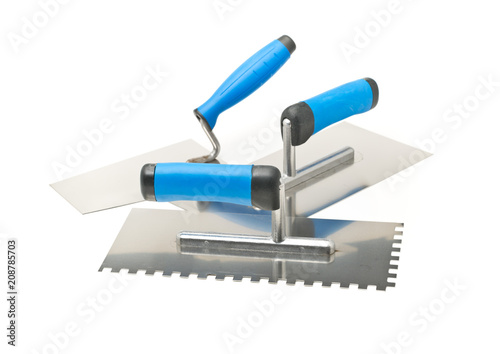 Photo  Masonry tools - trowels and notched trowel - on white