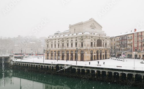Historic building at river in winter