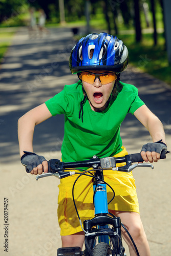 Poster Cycling excited boy riding bike
