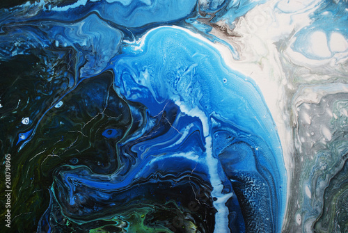 Creative blue abstract hand painted background, wallpaper, texture, close-up fragment of fluid acrylic painting. Cracked surface. Contemporary art.