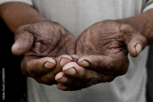 The poor old man's hands beg you for help Canvas Print