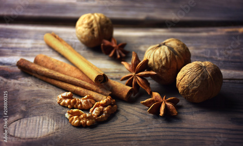 Fotobehang Kruiderij Anise stars, nuts, cinnamon, raisins for baking and cooking. Aromas of homemade food. Shallow depth of field.