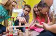 canvas print picture - Kinder in Kindergarten mit Erzieherin beim Spielen